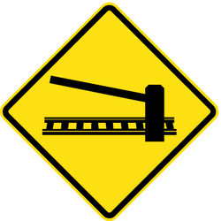 Traffic sign of Chile: Warning for a railroad crossing with barriers