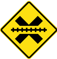 Traffic sign of Chile: Warning for a railroad crossing without barriers