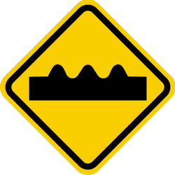 Traffic sign of Colombia: Warning for a bad road surface