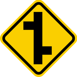 Traffic sign of Colombia: Warning for a crossroad where the roads are not opposite to each other