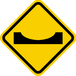 Traffic sign of Colombia: Warning for a dip in the road