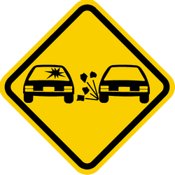 Traffic sign of Colombia: Warning for loose chippings on the road surface