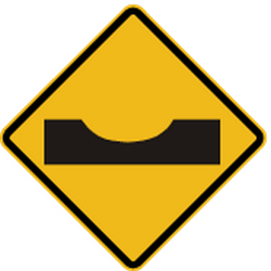Traffic sign of Peru: Warning for a dip in the road