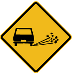 Traffic sign of Peru: Warning for loose chippings on the road surface