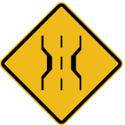 Traffic sign of Peru: Warning for a narrowing