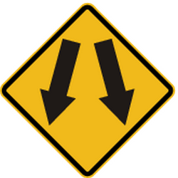 Traffic sign of Peru: Warning for an obstacle, pass left or right