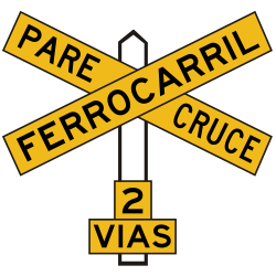 Traffic sign of Peru: Warning for a railroad crossing with more than 1 railway