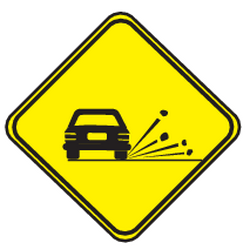 Traffic sign of Uruguay: Warning for loose chippings on the road surface