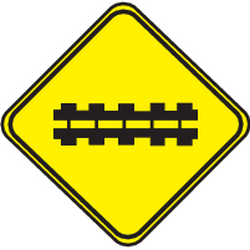 Traffic sign of Uruguay: Warning for a railroad crossing with barriers