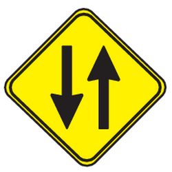 Traffic sign of Uruguay: Warning for a road with two-way traffic